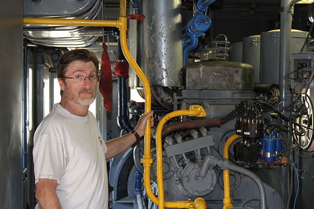 Project manager Bryan Reese with the original Winton gasoline engine in the M.177.